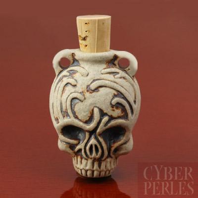 Pendentif-fiole en ceramique - tete de mort