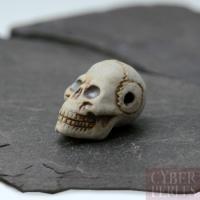 Perle en céramique - crâne allongé